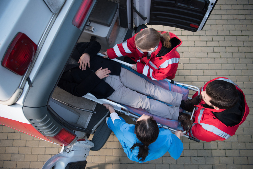 top view of an ambulance team caring for a patient with add plan